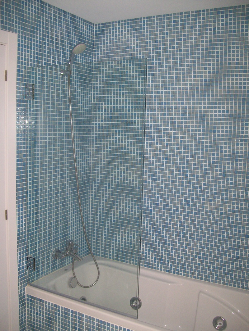 Mosaic bathroom with shower and jacuzzi bath